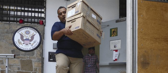 Staff carrying one of the many boxes of the US CONSULATE move in Monterrey City.