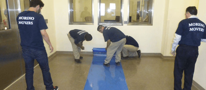 Applying floor protection to avoid scratches and damages.